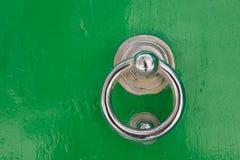 Silver door knocker on a green wooden door. Mdina, Malta Stock Photo