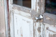 Silver doorknob on the old wood door. Renovate and maintenance concept Royalty Free Stock Images