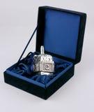 Silver Dreidel. In an elegant blue jewelry box Royalty Free Stock Photography