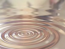 Silver drop. Silver circles generated by a drop stock image