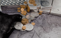 Silver Eagle Coins & Gold Eagle Coins with Silver bars on Map.  royalty free stock photos