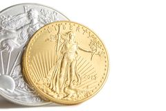 Silver eagle and golden american eagle one ounce coins royalty free stock photography