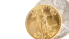 Silver eagle and golden american eagle one ounce coins stock image