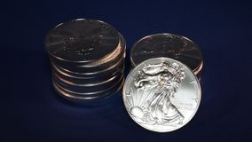 Precious Metals Money Silver Eagle American One Ounce Bullion Coins - Finance Illustration stock footage