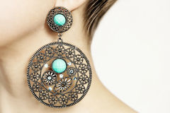 Silver earring with turquoise Stock Image