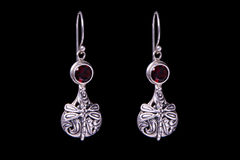 Silver earrings on a black background Royalty Free Stock Photography