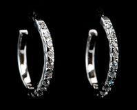 Silver earrings with diamonds Stock Photos