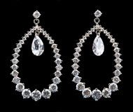 Silver earrings with diamonds Royalty Free Stock Images