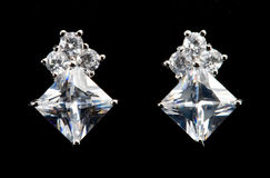 Silver earrings with diamonds Royalty Free Stock Photos