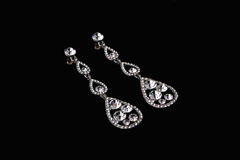 Silver earrings with diamonds Royalty Free Stock Image