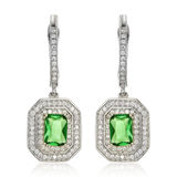 Silver earrings with emeralds  on white Royalty Free Stock Photo