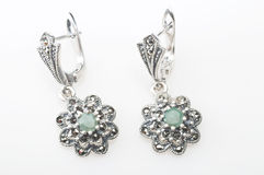 Silver earrings with gemstone Royalty Free Stock Photography