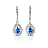 Silver earrings. Jewelry. Silver earrings with sapphires Royalty Free Stock Images