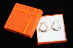 Silver earrings present. Silver earrings in box present jewellery Royalty Free Stock Images