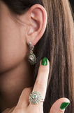 Silver earrings and ring with emerald Stock Images