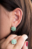Silver earrings and ring with emerald stone Stock Photo