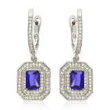 Silver earrings with sapphire isolated on white Stock Image