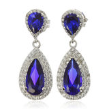 Silver earrings with sapphire  on white Royalty Free Stock Image