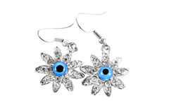 Silver earrings with stones in a daisy Stock Photography