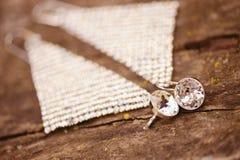 Silver earrings on wood stock photo