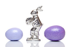 Silver easter bunny between colourful easter eggs Stock Photo