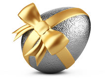 Silver easter egg with gold ribbon Stock Photos