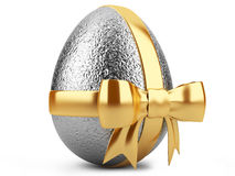 Silver easter egg with gold ribbon Royalty Free Stock Image