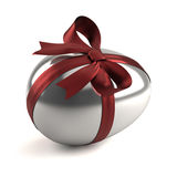 Silver easter egg with red ribbon Stock Photo