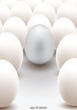 Silver egg standing out from the others Stock Photos