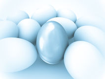 Silver egg among white eggs. Stock Images