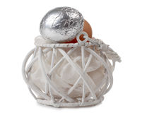 Silver eggs in basket Stock Photo