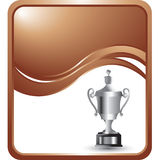 Silver elaborate trophy on a bronze wave backdrop Royalty Free Stock Photos
