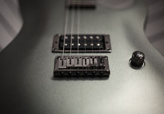 Silver Electric Guitar Body with Strings Stock Photos