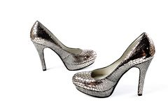 Silver elegant party winter high heel ankle shoes with zipper isolated white. Nice stock images