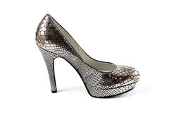 Silver elegant party winter high heel ankle shoes with zipper isolated white. Nice royalty free stock images