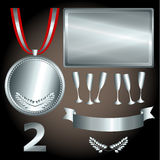 Silver elements for games and sports. Great sports and games related objects with second position silver medal, ribbon and position number Royalty Free Stock Photo