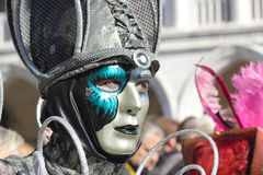 Silver and emerald mask at the Carnival of Venice Stock Photo