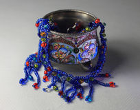 Silver and enamel. Silver box and necklace from glass beads Stock Photography