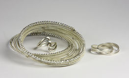 Silver Ensemble. Ensemble of two silver rings and bracelet Stock Images