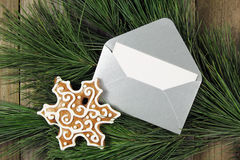 Silver envelope with gingerbread on christmas fir tree Royalty Free Stock Images