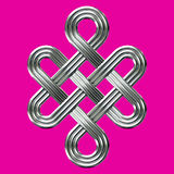 Silver eternal knot charm symbol. Luxury silver endless knot (Eternal knot) is a cultural symbol across Buddhism, Tibet and Chinese Art with the Meaning of Karma Royalty Free Stock Images