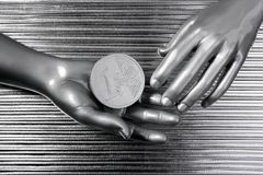 Silver euro coins in futuristic robot hands Stock Photo