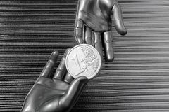 Silver euro coins in futuristic robot hands Stock Images