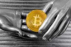 Silver euro coins in futuristic robot hands. Bitcoin BTC cryptocurrency on silver futuristic hands Stock Photos