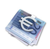 Silver euro money clip  and folded euros  path. A silver euro money clip  and folded euros with clipping path at an angle Stock Image