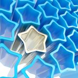 Silver extruded star among blue ones as background Stock Photography