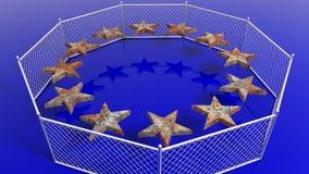 Silver fence around European Union flag's rusty stars Stock Photo