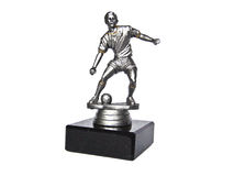 The silver figurine of football player. The silver statue of the football player with a ball on the black square plinth Stock Photography