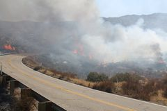 The Silver Fire In Beaumont California ~ 2013 ~ Fire Burning Along Road Stock Photos