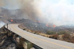 The Silver Fire In Beaumont California ~ 2013 ~ Fire Burning Along Road On Both Sides Royalty Free Stock Photography